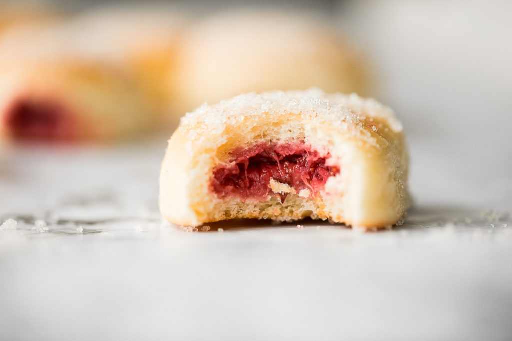 These melt-in-your-mouth, homemade baked jelly donuts, coated in sugar and filled with sweet strawberry jam, are so soft, fluffy, spongy and airy. | aheadofthyme.com