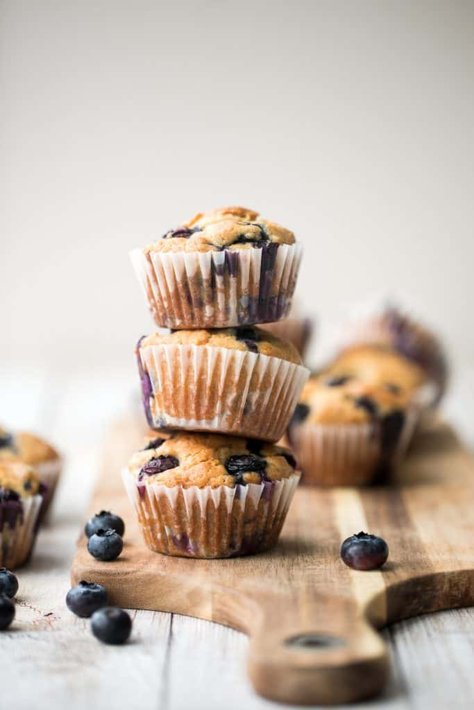 Blueberry yogurt muffins are buttery, moist, soft, and cakey and bursting with blueberries in every single bite. They are super quick and easy to make. | aheadofthyme.com