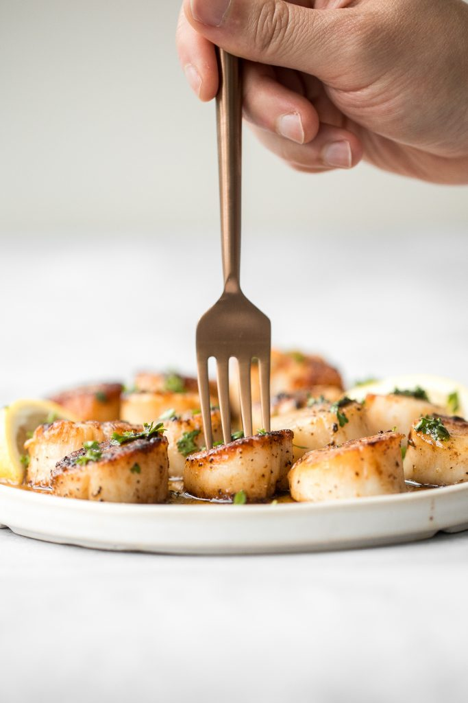 Garlicky, buttery, and perfectly seared scallops take less than 10 minutes to prep and cook. It's the easiest fancy, restaurant-grade meal to make at home. | aheadofthyme.com