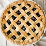 Summery classic blueberry pie is made with the perfect flaky pie crust, a jammy blueberry filling with a hint of lemon, and sealed with a lattice top. | aheadofthyme.com