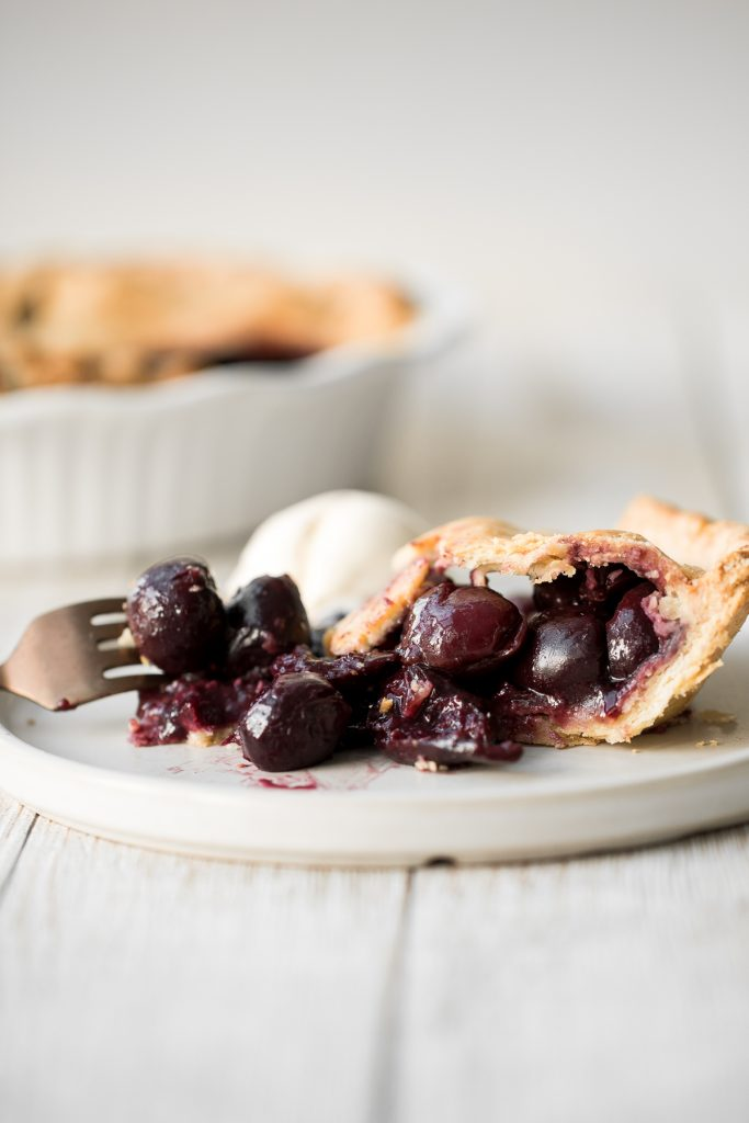Summery and fruity, classic cherry pie has the most flakey and buttery pie crust on the bottom and top and is filled with a delicious cherry-packed filling. | aheadofthyme.com