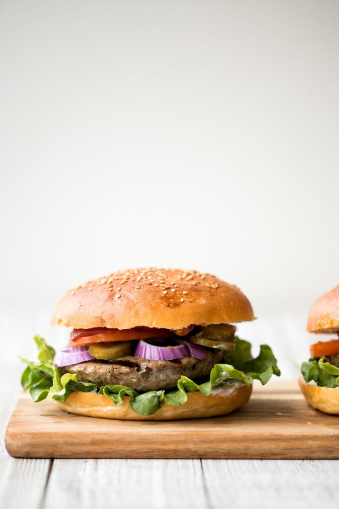 Better than the steakhouse, these classic juicy hamburgers are perfectly seasoned, so flavourful and delicious. Make them on the grill or on the stove. | aheadofthyme.com