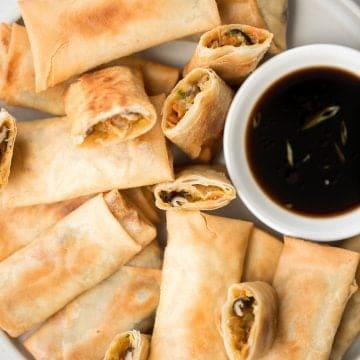 Better than takeout, light and crispy fried vegetarian spring rolls are packed with a tender mushroom and cabbage vegetarian filling in a crunchy skin. | aheadofthyme.com
