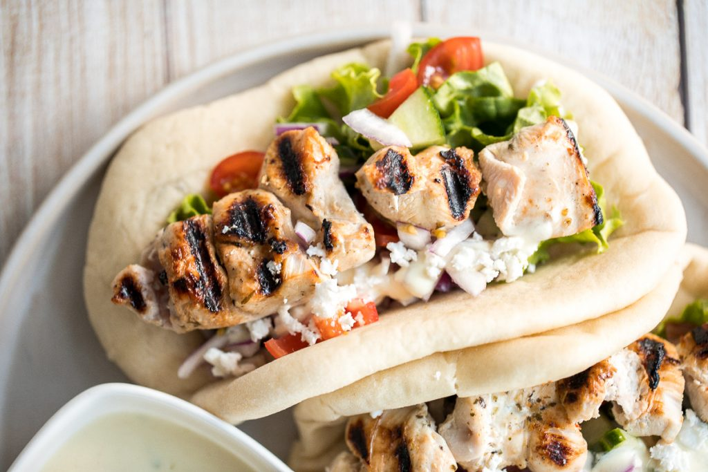 This refreshing and light, easy Greek chicken gyros is packed with tender souvlaki chicken, Greek salad, and homemade tzatziki sauce, all wrapped in a pita. | aheadofthyme.com