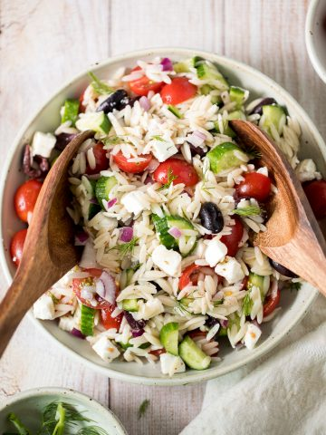 Quick and easy Mediterranean orzo pasta salad packed with fresh vegetables and herbs is tossed in a Greek lemon vinaigrette. Healthy, light and delicious. | aheadofthyme.com