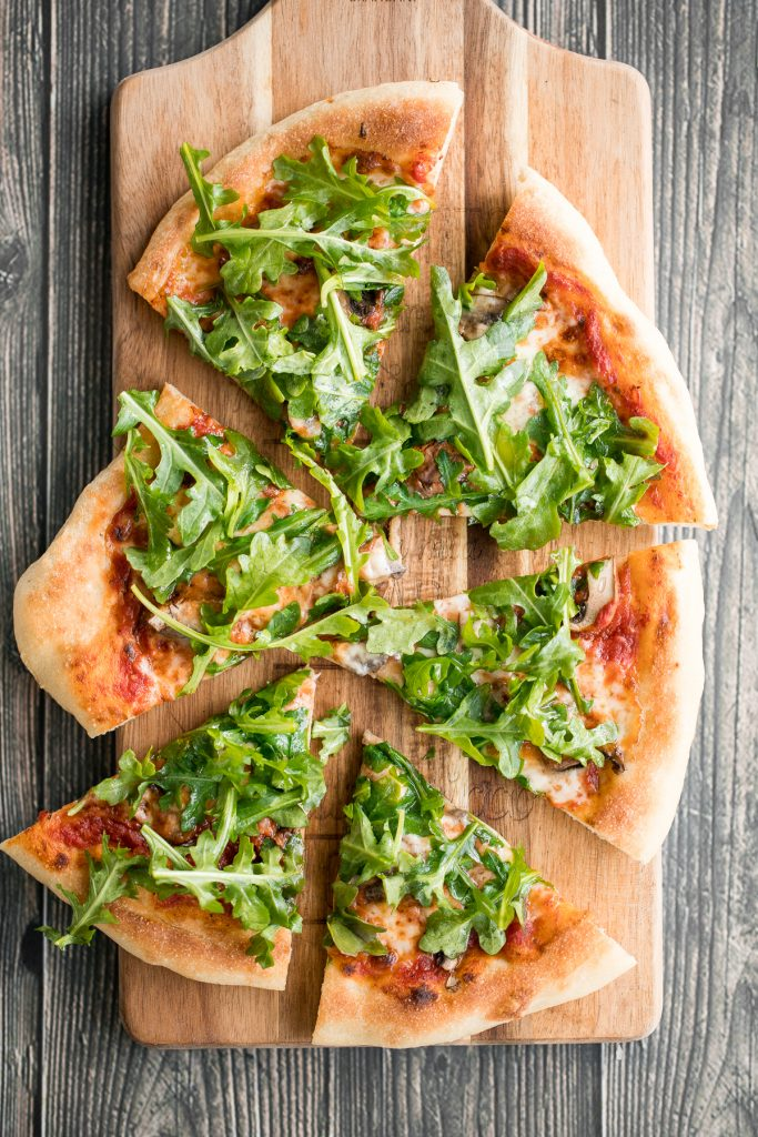 Easy and delicious homemade mushroom and arugula skillet pizza with a perfectly crispy pizza crust is topped with mushrooms, arugula, and mozzarella cheese. | aheadofthyme.com