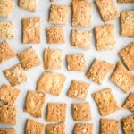 Quick and easy sourdough discard crackers are thin, crispy, crunchy and flavoured with sesame seeds, dried herbs and flaked salt. They are so addictive. | aheadofthyme.com