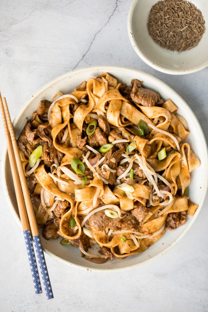 Better than takeout, flavourful stir-fried spicy cumin lamb noodles is packed with marinated lamb, noodles, and crisp bean sprouts. Make it in 15 minutes. | aheadofthyme.com