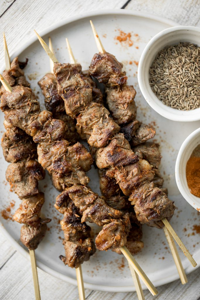 Juicy and tender, Xinjiang spicy cumin lamb skewers with a bold cumin and cayenne marinade, are so flavourful and easy to make on the grill or air fryer. | aheadofthyme.com