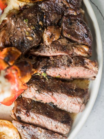 Better than the steakhouse, the best tender and juicy ribeye steak with a perfect seared crust is garlicky, buttery and packed with so much flavour. | aheadofthyme.com