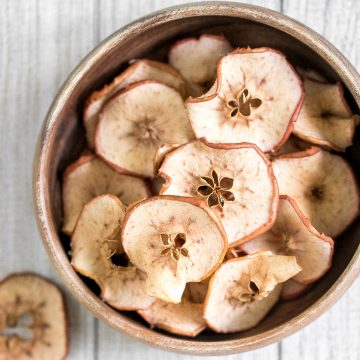 One-ingredient homemade baked apple chips are healthy, light, crispy and so addictive. They contain no added sugar and are so easy to make at home. | aheadofthyme.com