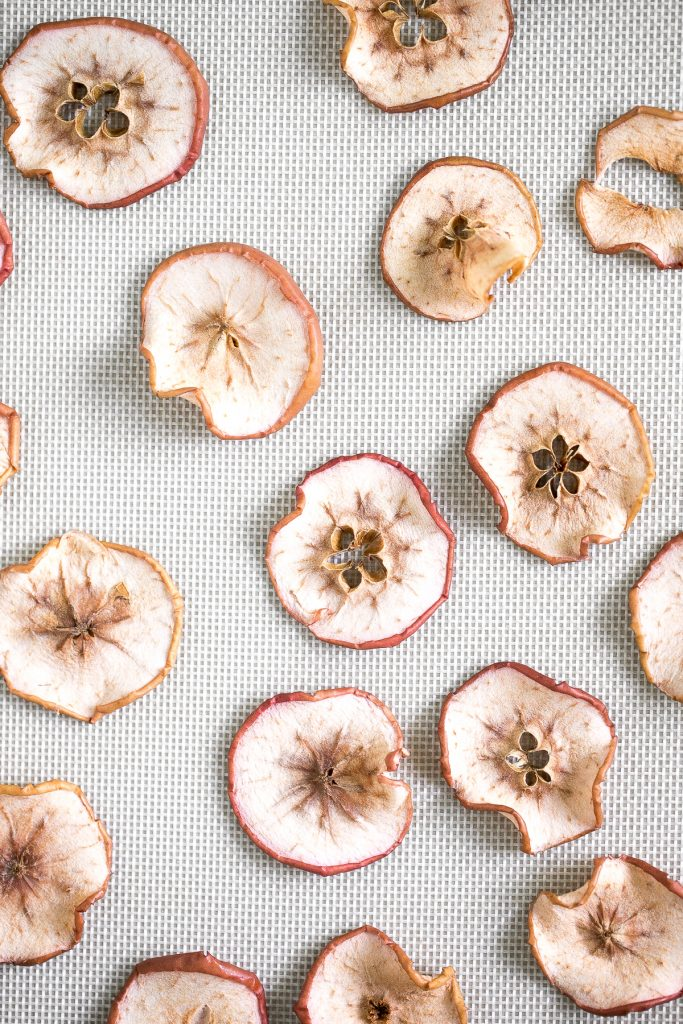 One-ingredient homemade baked apple chips are healthy, light, crispy and so addictive. They contain no added sugar and are so easy to make at home.   aheadofthyme.com