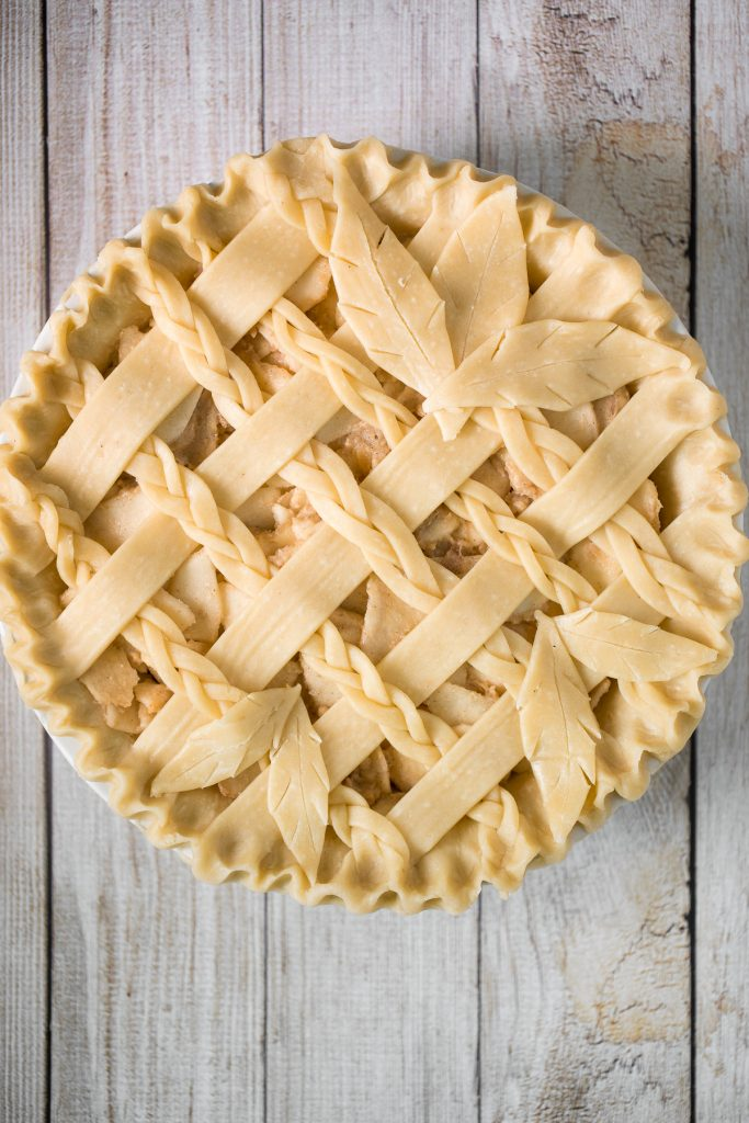 This braided lattice apple pie is packed with cinnamon apples tossed in a caramel sauce and sealed in a buttery, flaky pie crust with a braided lattice top. | aheadofthyme.com