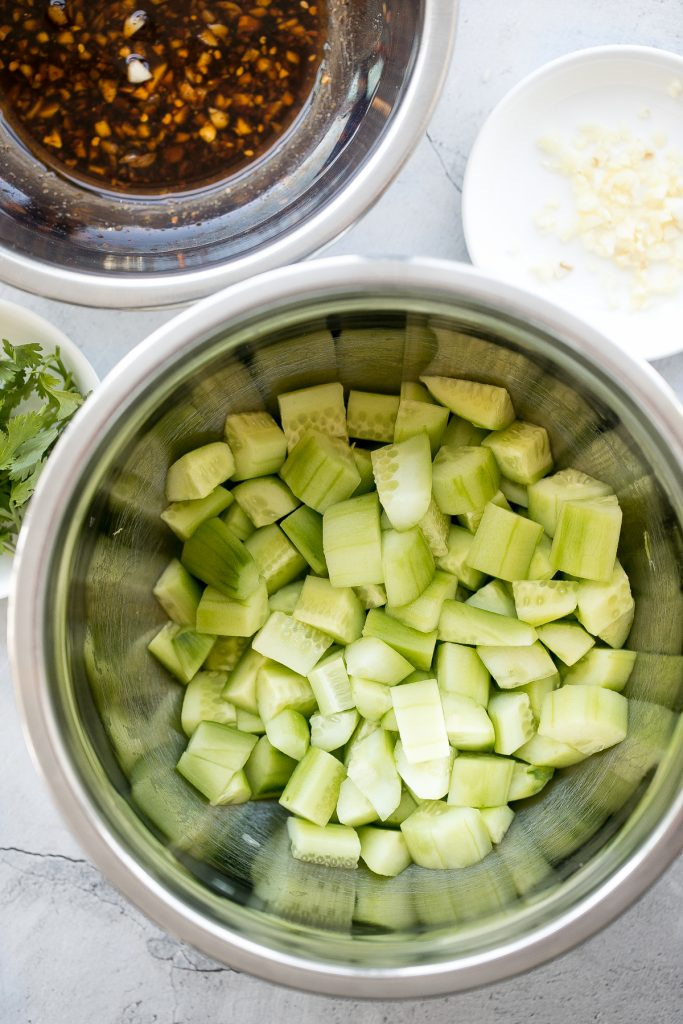 Light, refreshing and crisp Chinese garlic cucumber salad is a quick and easy, simple salad tossed in an Asian dressing and packed with a ton of flavour. | aheadofthyme.com