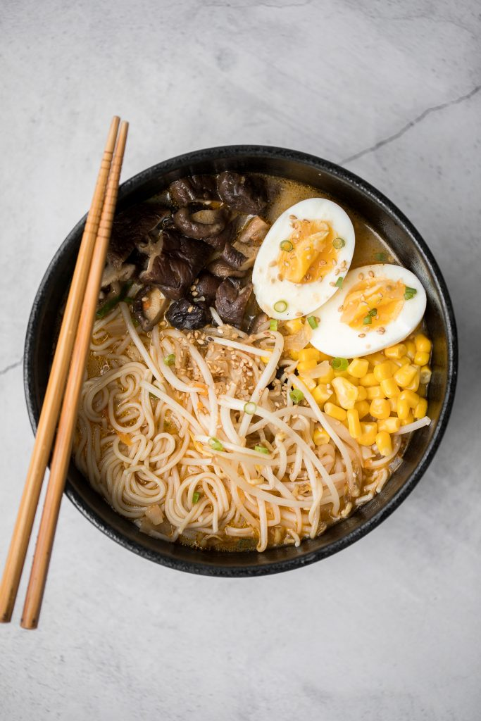 Vegetarian peanut miso ramen with a creamy vegan soup base, is topped with noodles, vegetables, and a perfect soft-boiled egg. Make it in just 20 minutes. | aheadofthyme.com