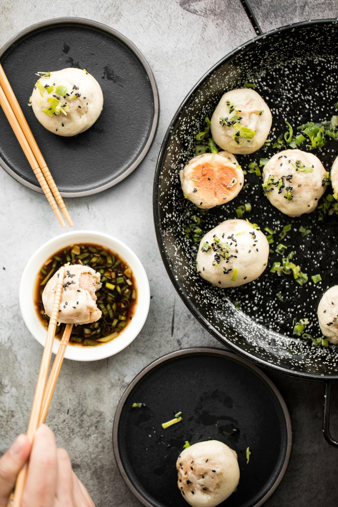 Crispy bottom Shanghai pan-fried pork buns are crunchy on the bottom and fluffy and airy inside with a juicy and flavourful pork and spring onions filling. | aheadofthyme.com