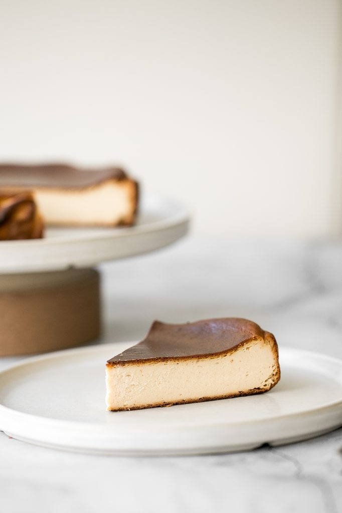 Easy no crust burnt Basque cheesecake is the easiest one bowl recipe. It is perfectly caramelized on the top and edges and creamy yet firm on the inside. | aheadofthyme.com