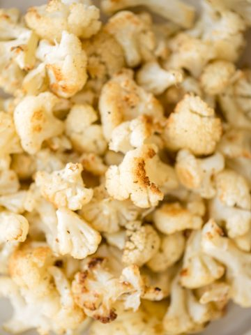 Quick and easy roasted cauliflower is a delicious, flavourful side dish that you throw on a sheet pan and into the oven. Plus, it's vegan and gluten-free.   aheadofthyme.com