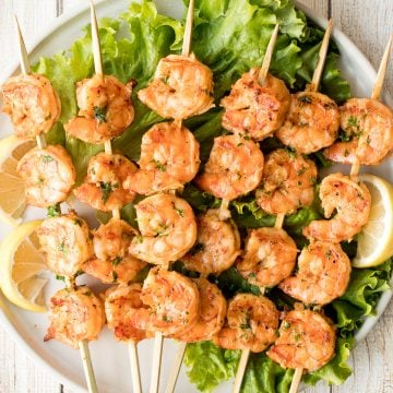 Juicy and tender grilled cajun shrimp skewers are garlicky, lemony, and packed with flavour by the cajun marinade. Ready in under 30 minutes including prep. | aheadofthyme.com