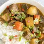 Warm and cozy, easy one pot coconut curry beef stew is hearty yet creamy, packed with tender beef chunks, potatoes and carrots, and creamy coconut milk. | aheadofthyme.com