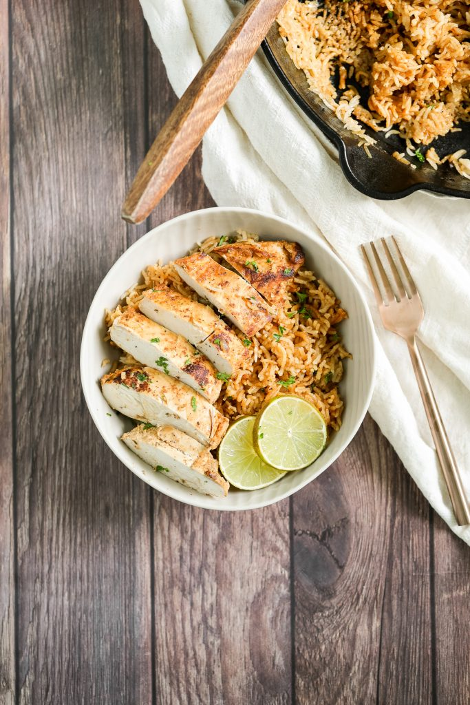 Creamy, delicious and flavourful, Thai-inspired one pot coconut curry chicken and rice is a 30-minute weeknight meal made with red curry and coconut milk. | aheadofthyme.com