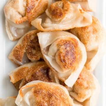 Better than takeout pan-fried pork and shrimp wontons are so crispy outside and tender and juicy inside with a savoury pork, shrimp and vegetable filling. | aheadofthyme.com