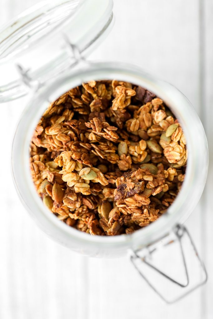 Quick and easy pumpkin pie granola packed with oats, pumpkin, pumpkin spice, and nuts, is vegan, gluten-free, and refined sugar-free. The best fall snack. | aheadofthyme.com