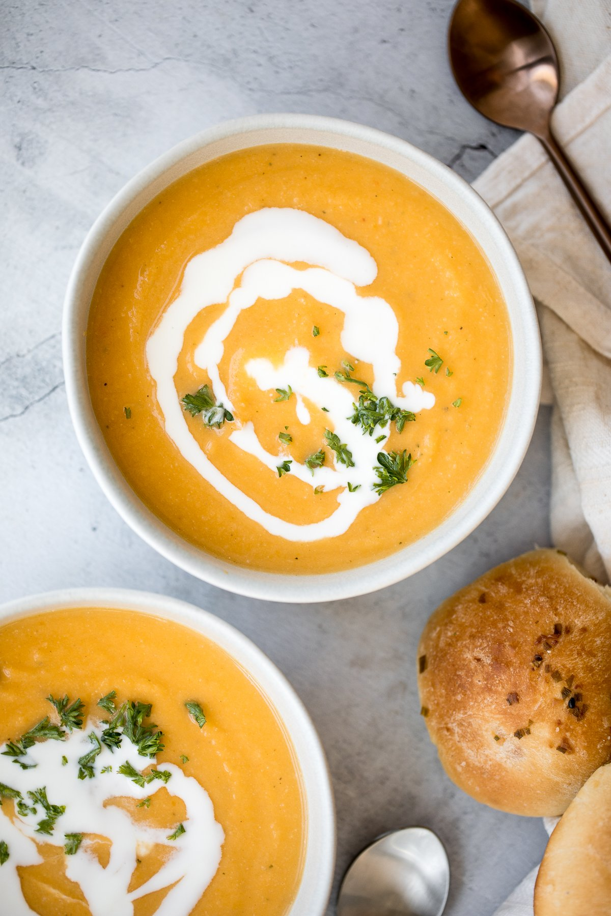 Creamy roasted butternut squash and cauliflower soup has all the fall feels and is vegan and gluten-free. Plus, it's super easy to make in a sheet pan. | aheadofthyme.com