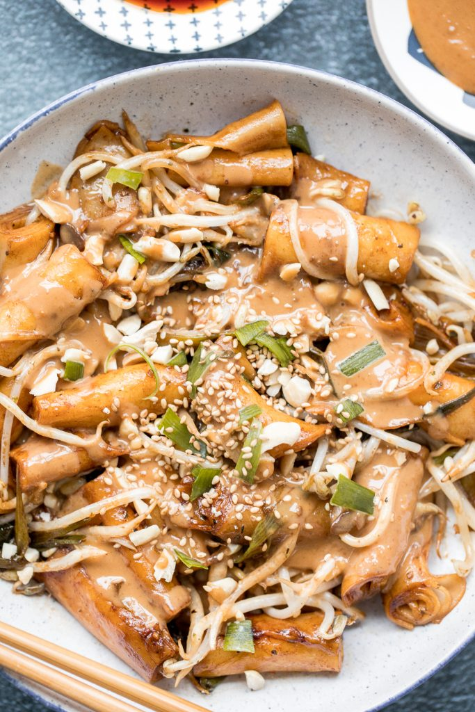 Better than takeout, quick and easy one pan stir-fried rice noodle rolls with peanut butter sauce is the best weeknight stir fry, ready in under 10 minutes. | aheadofthyme.com