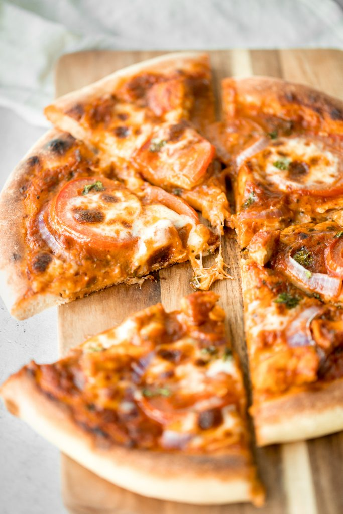 Quick, easy, delicious and saucy leftover butter chicken pizza with an ultra crispy pizza crust is made entirely in a cast-iron skillet in just 10 minutes. | aheadofthyme.com