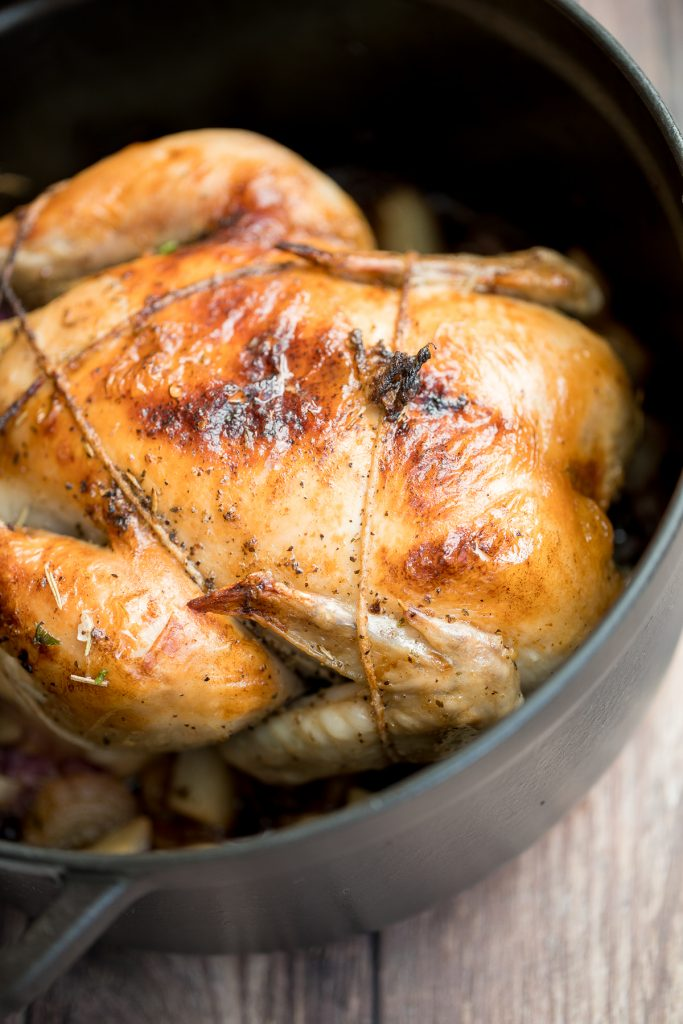 Easy Dutch oven whole roast chicken with the crispiest golden skin is juicy, tender and succulent and packed with flavour. Just takes 15 minutes to prep. | aheadofthyme.com