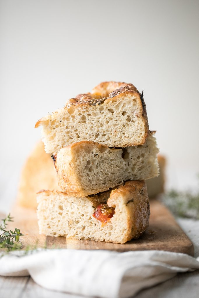 Easy no knead tomato focaccia is so flavourful, packed with olive oil, tomatoes and fresh herbs. It's crispy and golden outside, fluffy and pillowy inside. | aheadofthyme.com