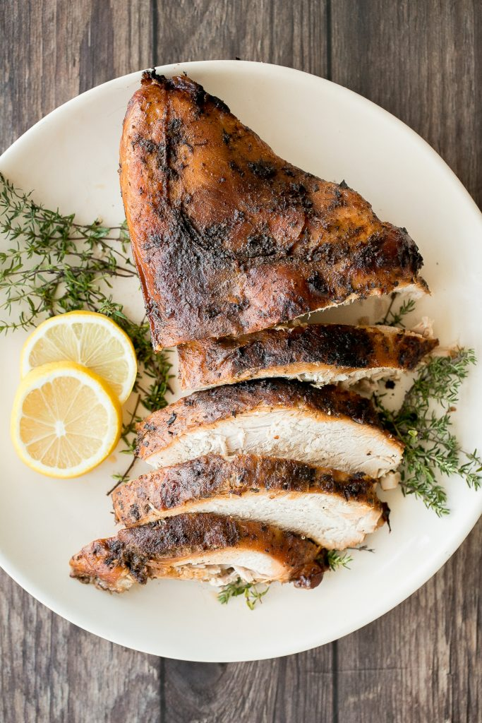 Soft, tender and juicy slow cooker turkey breast with the crispiest skin and fresh fall herbs is the easiest way to cook a turkey this holiday season. | aheadofthyme.com