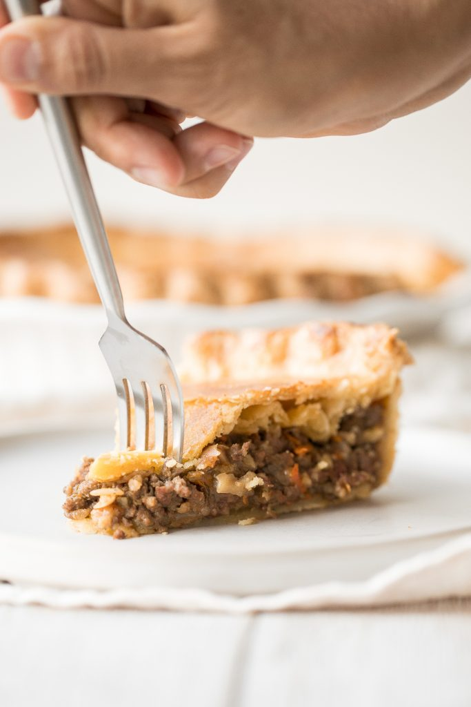 Ground beef meat pie with a flaky puff pastry double crust pie is filled with ground beef cooked with vegetables and seasonings. The ultimate comfort food. | aheadofthyme.com