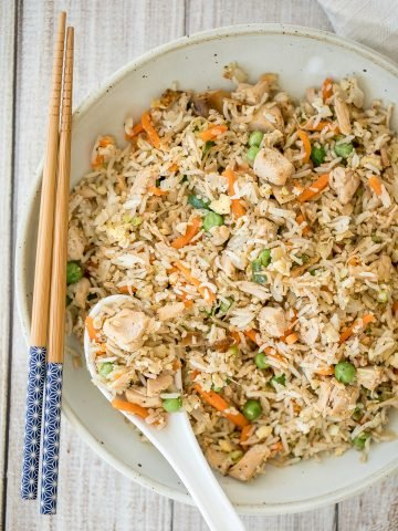 Leftover turkey fried rice with turkey, fluffy rice, scrambled eggs, vegetables, and classic Asian seasonings is a one skillet meal made in just 10 minutes.   aheadofthyme.com