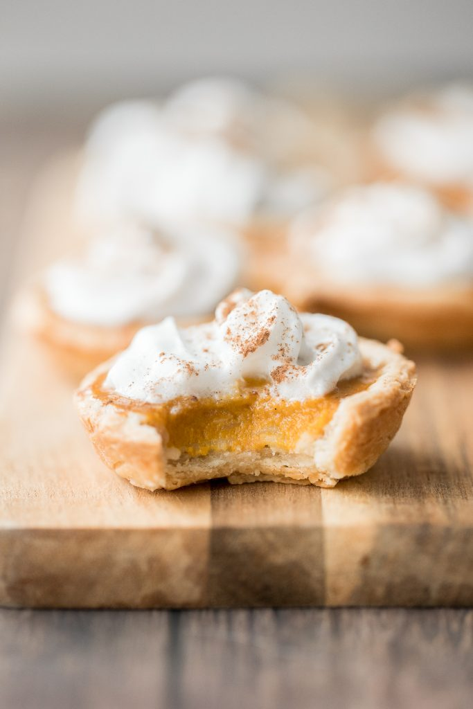 Small batch mini pumpkin pies with a flaky crust, delicious pumpkin pie filling, and cinnamon whipped cream, are perfect for a small Thanksgiving crowd. | aheadofthyme.com
