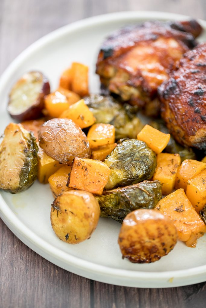 One pan roasted harvest vegetables with butternut squash, brussels sprouts and baby potatoes is the best fall side dish. So easy to prep in just minutes. | aheadofthyme.com