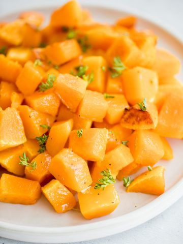 Roasted butternut squash is the easiest vegan side dish you need this fall. It has a ton of flavour with just a few simple pantry staples.   aheadofthyme.com