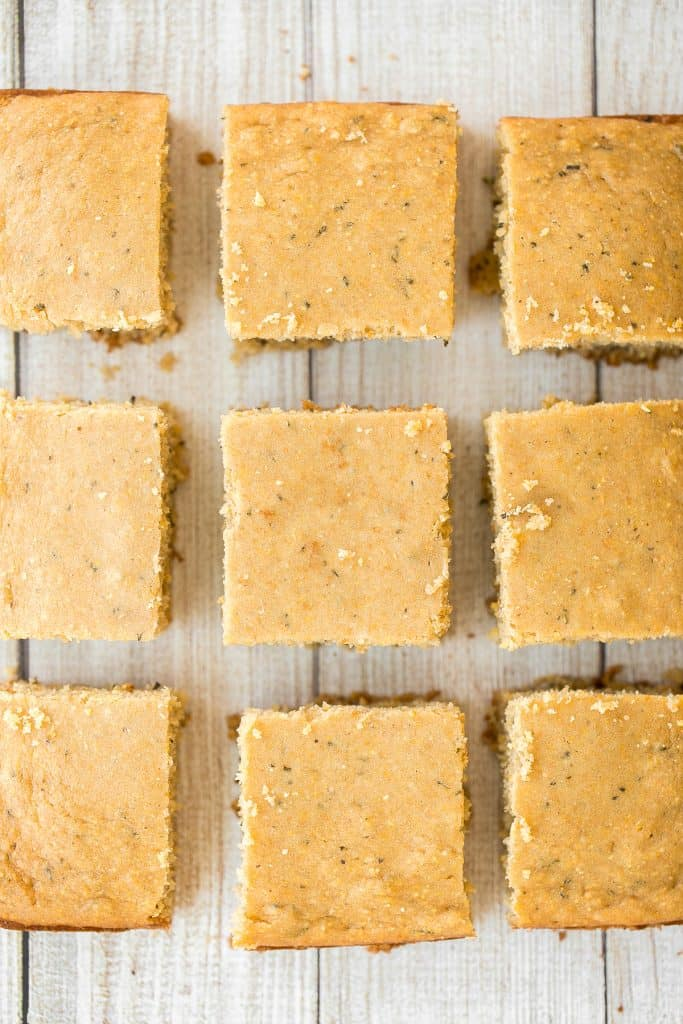 Sweet and savoury, buttery rosemary cornbread is soft and moist with golden crispy edges, flavourful and delicious, and so easy to make this holiday season. | aheadofthyme.com