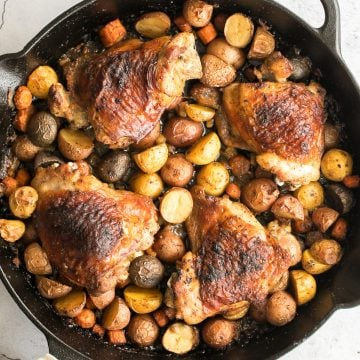 Tender, juicy, and crispy one pan skillet chicken thighs and potatoes and carrots is an easy weeknight dinner on your dinner table in less than 45 minutes. | aheadofthyme.com