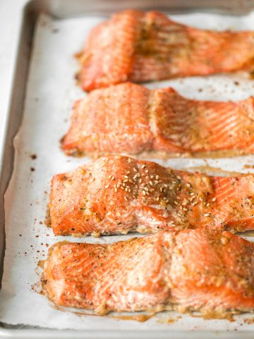 Quick and easy baked maple salmon is so delicious, flaky and flavourful with the perfect balance between sweet and savoury. The best weeknight dinner. | aheadofthyme.com