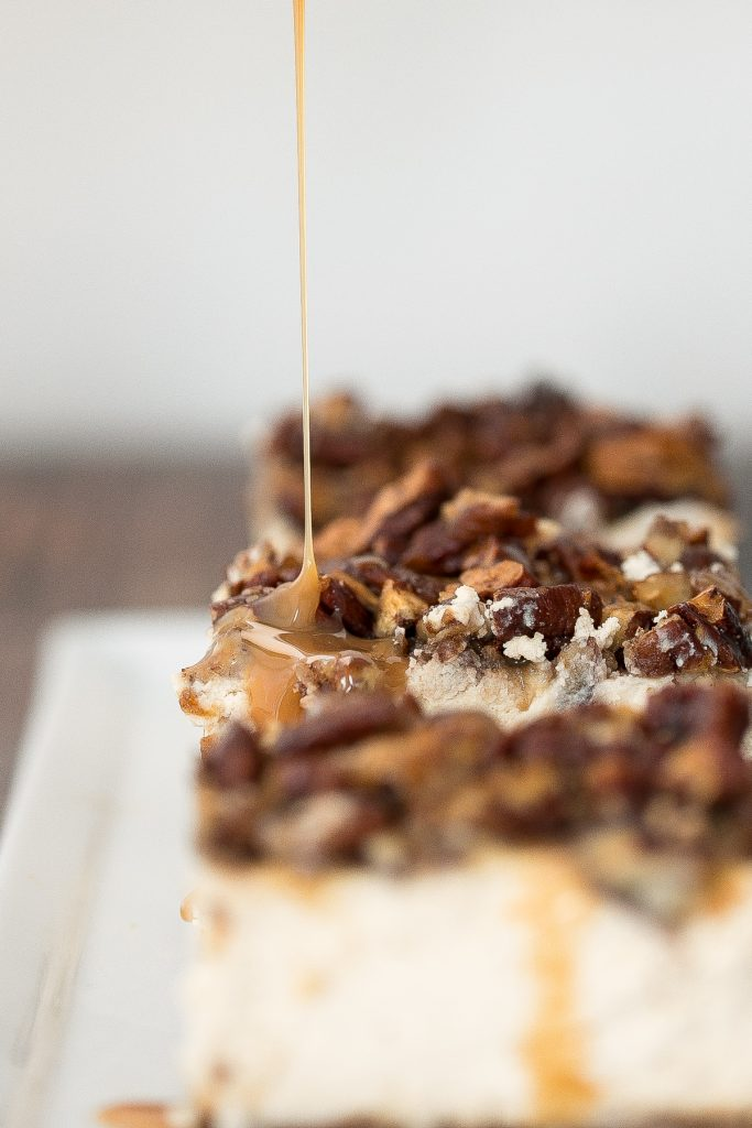 Decadent caramel pecan pie cheesecake bars with a graham cracker crust, cheesecake filling, and caramel pecan topping is perfect for Thanksgiving this fall. | aheadofthyme.com