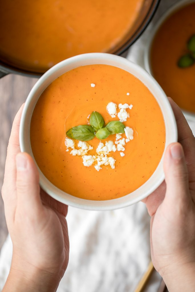 Make this silky smooth and creamy tomato potato soup in under 25 minutes. This gluten-free vegan soup is healthy and filling and the easiest weeknight meal. | aheadofthyme.com