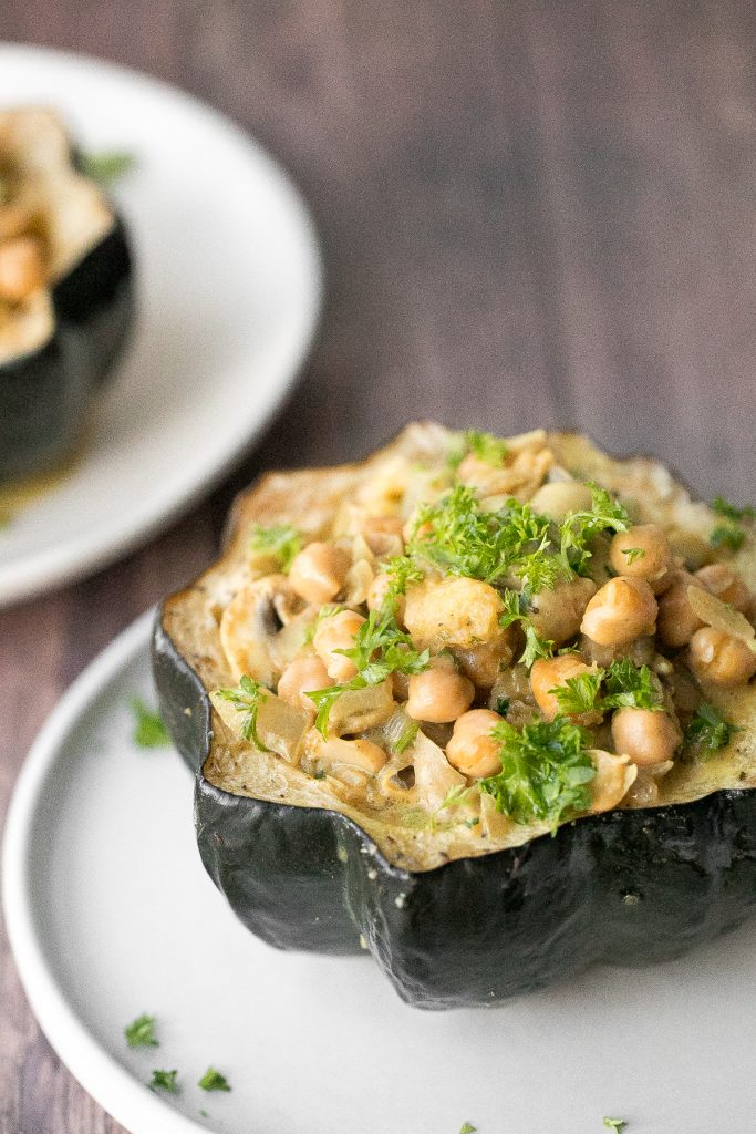 Wholesome, hearty, curried chickpea stuffed acorn squash with curry flavours is the perfect vegan and gluten-free fall comfort food for your holiday dinner. | aheadofthyme.com