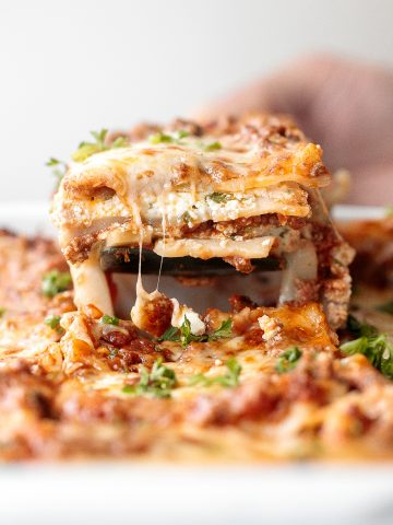 Classic easy meat lasagna is the ultimate Italian comfort food with layers of tender lasagna, meaty tomato sauce, cheese filling and melted cheese on top. | aheadofthyme.com