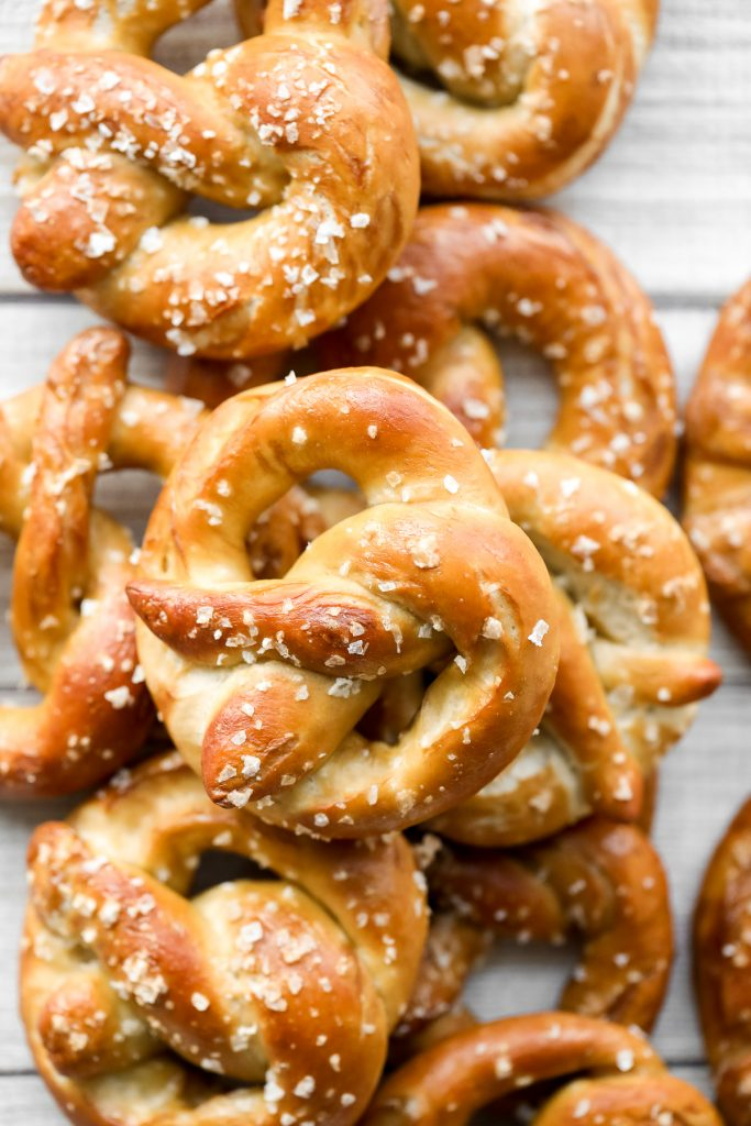 The best quick and easy salted soft pretzels are buttery, salty, and so delicious. They are golden brown and chewy on the outside, yet warm and soft inside. | aheadofthyme.com
