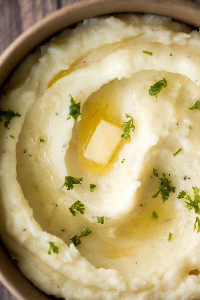 Velvety and smooth, garlic mashed potatoes with sour cream are the best, flavourful make-ahead side dish ever. Garlicky, buttery, creamy, and pure comfort. | aheadofthyme.com