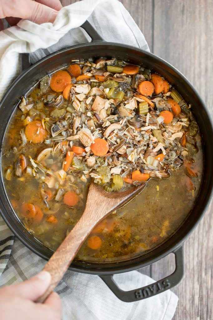 Wholesome hearty one pot leftover turkey wild rice soup is the most comforting way to use leftover turkey from Thanksgiving turkey dinner. So easy to make. | aheadofthyme.com