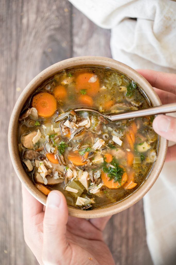 Wholesome hearty one pot leftover turkey wild rice soup is the most comforting way to use leftover turkey from Thanksgiving turkey dinner. So easy to make.   aheadofthyme.com