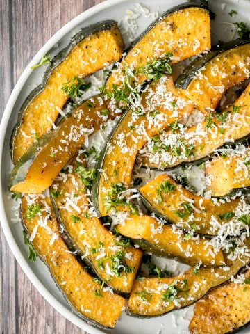 Soft and tender, easy roasted pumpkin wedges with Parmesan cheese is the easiest and most delicious side dishes to make this fall. Prep it in just minutes.   aheadofthyme.com